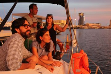 People watching the sunset from a yacht in Barcelona