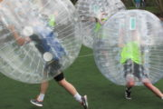 Teams playing Bubble football in Barcelona