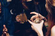 Women smiling during Barcelona bar crawl